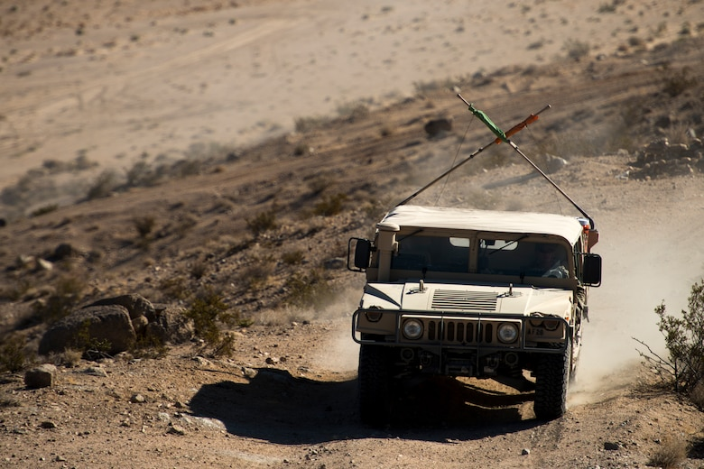 Staff Sgt. Dustin Selljes, 12th Combat Training Squadron joint terminal attack controller, drives a Humvee up a mountain during Green Flag West, June 12, 2018, at the National Training Center, Ft. Irwin, California. The NTC replicates the tough, realistic operational environment that America's war fighters face in combat. (U.S. Air Force photo by Airman 1st Class JaNae Capuno)
