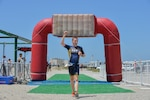 NAVAL BASE VENTURA COUNTY - POINT MUGU, Calif. (June 9, 2018) U.S. Navy Lt. Kyle Hooker of Bremerton, Wash. finishes in first place for the fourth year in a row at the 2018 Armed Forces Triathlon Championship. During the triathlon, service members competed both individually and as a team to Olympic distances of a 1,500-meter (approximately 1-mile) open-water swim, followed by a 40-kilometer (24.8-mile) bike ride, and finishing with a 10-kilometer (6.2-mile) run.  Additionally, teams competed for points and spots on the U.S. Armed Forces Team that will compete at the Conseil International du Sport Militaire (CISM) World Military Triathlon Championship in Lidkoping, Sweden from 15-18 June 2018. (U.S. Navy photo by Mass Communication Specialist Seaman Dan Willey/Released)