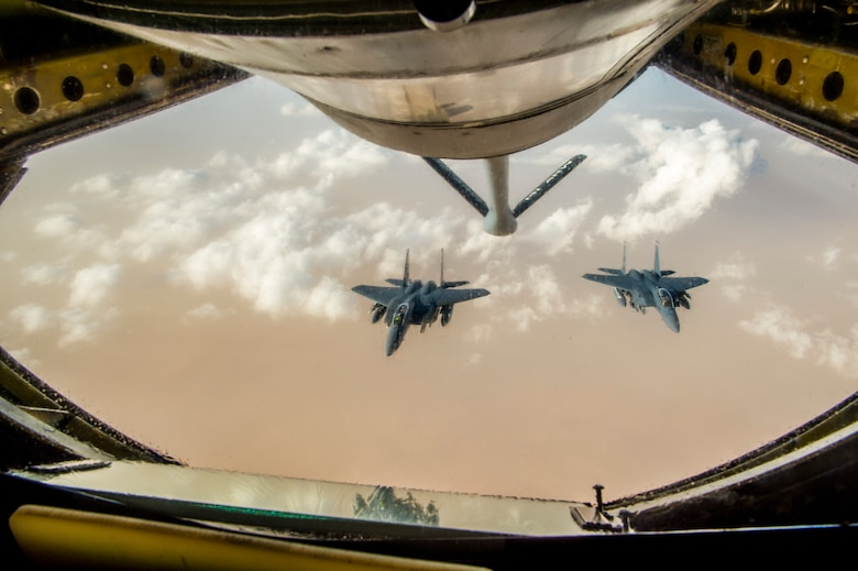 Two U.S. Air Force  F-15 Eagles fly in formation after receiving fuel from a KC-135 Stratotanker assigned to the 340th Expeditionary Air Refueling Squadron during a aerial refueling mission in support of Operation Inherent Resolve over Iraq, May 5, 2018. The 340th EARS is assigned to the 379th Expeditionary Operations Group and supports various operations in countries such as Iraq, Syria and Afghanistan