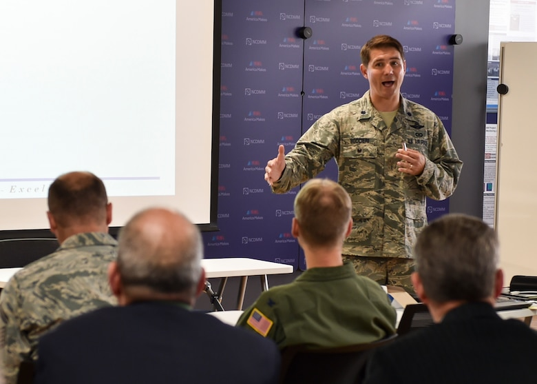 Lt. Col. John Boccieri, director of the 910th Airlift Wing Commander's Action Group, addresses the benefits of the Air Force Community Partnership Program during a meeting at America Makes in Youngstown, June 14, 2018.