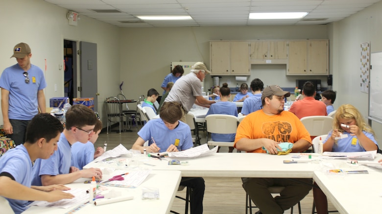 Participants of the Reach for the Stars competition held June 2 at the Hands-On Science Center work on building and designing their rockets. Students ages 10-18 from across southern middle Tennessee were invited to participate in the event. (Courtesy photo)