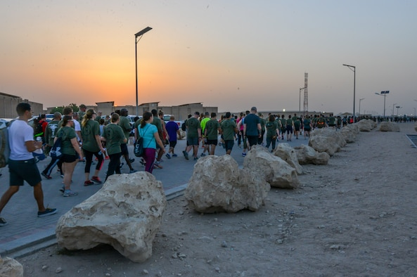 Service members participate in a mental health awareness walk at Al Udeid Air Base, Qatar, May 31, 2018. The walk was hosted by the 379th Expeditionary Medical Group Mental Health Clinic to raise awareness to the many resources available for those experiencing negative mental health symptoms. (U.S. Air Force photo by 1st Lt. Katie Spencer)
