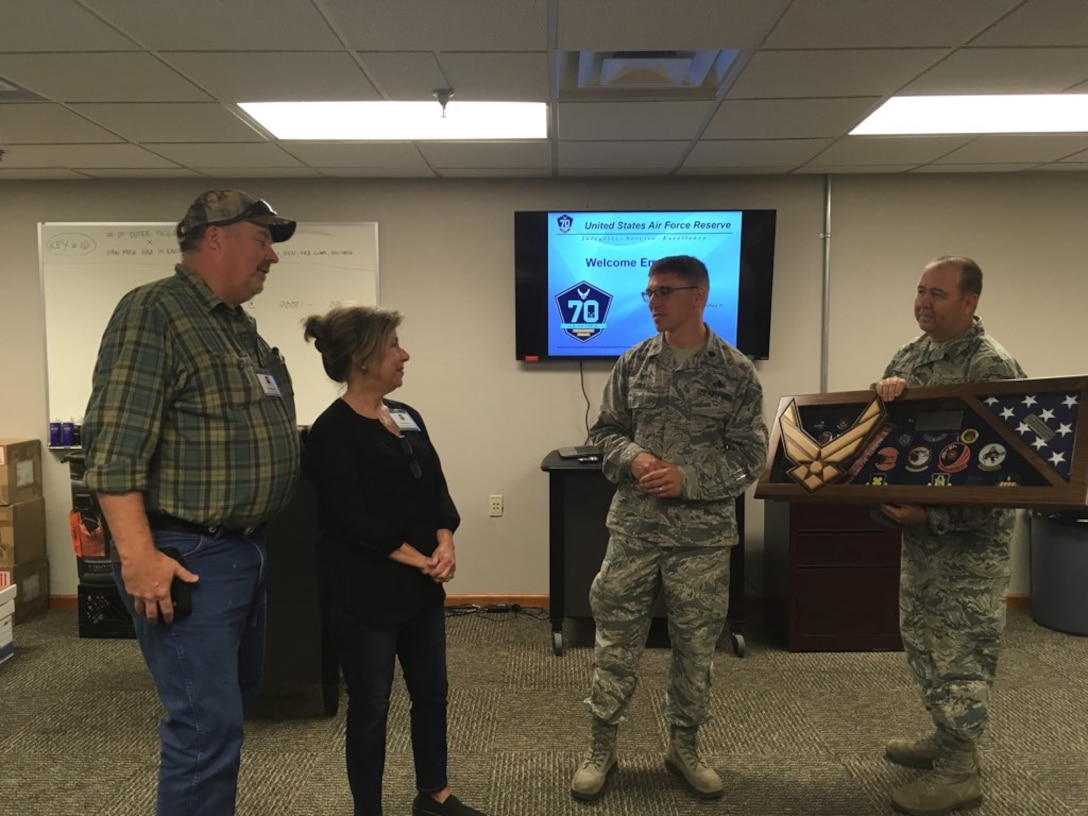 Hal Moore and his wife, Christy, accept a shadow box from U.S. Air Force Lt. Col. George Cole, 307th Maintenance Squadron commander and Master Sgt. Gene Watkins, 307th MXS metals technology supervisor, during Employer Appreciation Day at Barksdale Air Force Base, June 2, 2018.   The 307th MXS expressed their appreciation to Moore, owner of Moore Metal Plating Corporation, for his unwavering commitment to the Air Force mission for the past several decades. (U.S. Air Force photo by Staff Sgt. Callie Ware/released)