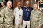 Lt. Col. (Chaplain) Bill Draper and Col. (Chaplain) Yong Cho visit with two KBR employees attending the Iftar on Camp Lemonnier in Djibouti, Africa May 21, 2018.
