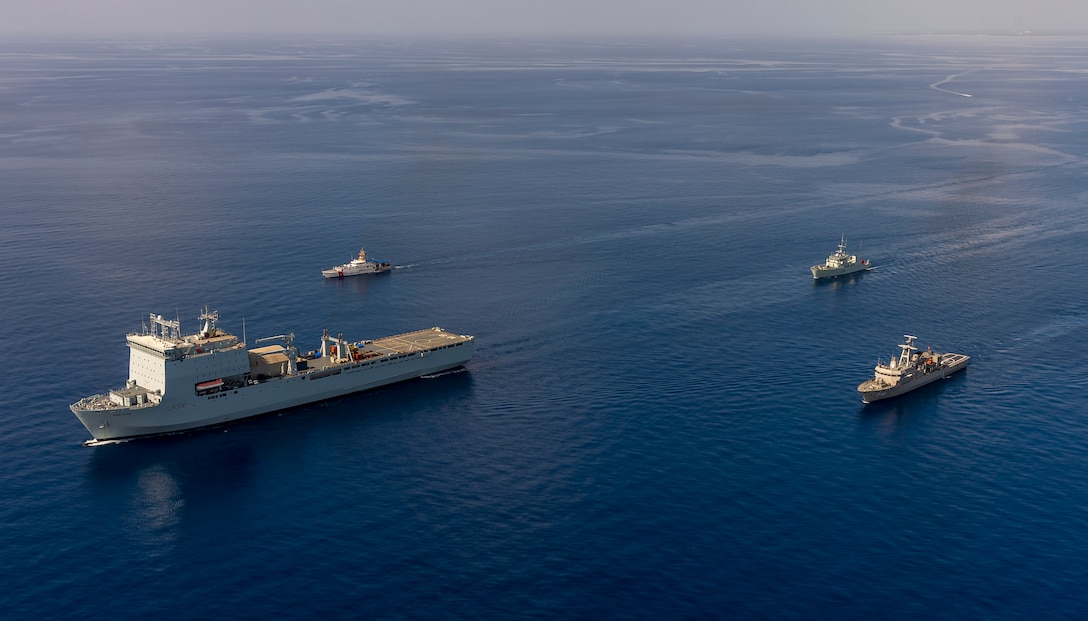 Ships sail in formation in the Atlantic Ocean.