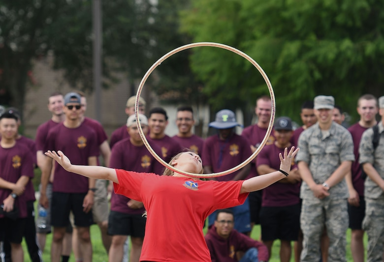 "U.S. Air Force Airman 1st Class Miranda Hayes, 335th Training Squadron student, performs a hula hoop act during the 81st Training Group drill down on the Levitow Training Support Facility drill pad at Keesler Air Force Base, Mississippi, June 15, 2018. Airmen from the 81st TRG competed in a quarterly open ranks inspection, regulation drill routine and freestyle drill routine. The 338th TRS ""Dark Knights"" took first place overall this quarter. (U.S. Air Force photo by Kemberly Groue)"