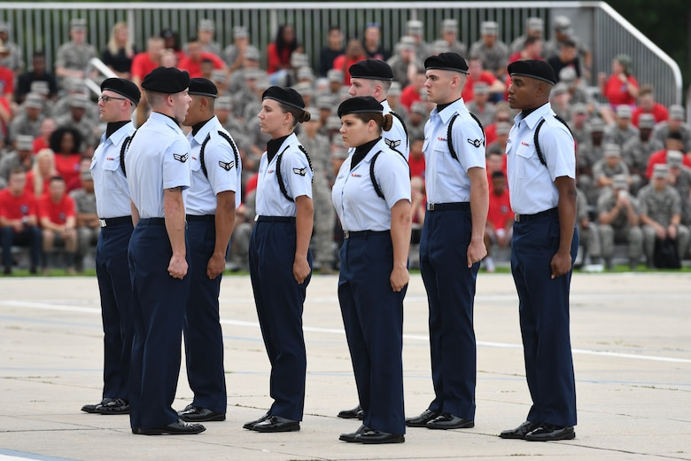 Members of the 334th Training Squadron regulation drill team perform during the 81st Training Group drill down on the Levitow Training Support Facility drill pad at Keesler Air Force Base, Mississippi, June 15, 2018. Airmen from the 81st TRG competed in a quarterly open ranks inspection, regulation drill routine and freestyle drill routine. (U.S. Air Force photo by Kemberly Groue)