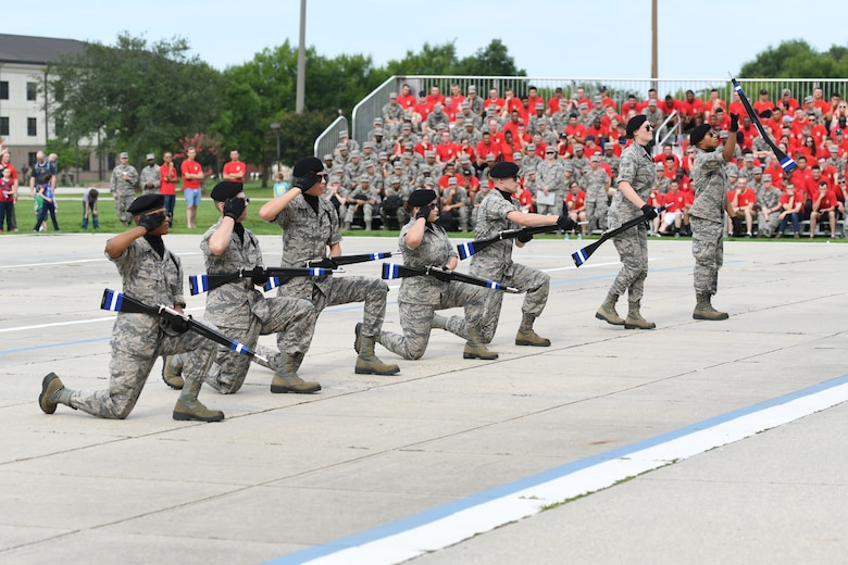 Members of the 334th Training Squadron freestyle drill team perform during the 81st Training Group drill down on the Levitow Training Support Facility drill pad at Keesler Air Force Base, Mississippi, June 15, 2018. Airmen from the 81st TRG competed in a quarterly open ranks inspection, regulation drill routine and freestyle drill routine. (U.S. Air Force photo by Kemberly Groue)