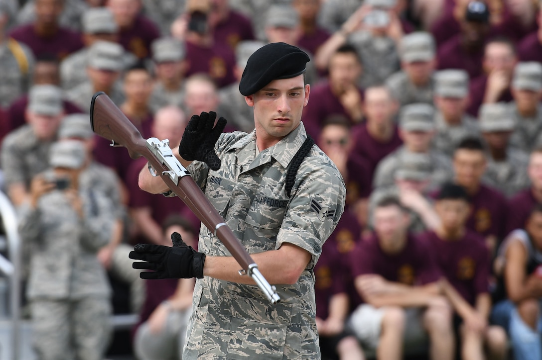 """U.S. Air Force Airman 1st Class Colton Burk, 338th Training Squadron duty title, performs during the 81st Training Group drill down on the Levitow Training Support Facility drill pad at Keesler Air Force Base, Mississippi, June 15, 2018. Airmen from the 81st TRG competed in a quarterly open ranks inspection, regulation drill routine and freestyle drill routine. The 338th TRS """"Dark Knights"""" took first place overall this quarter. (U.S. Air Force photo by Kemberly Groue)"""