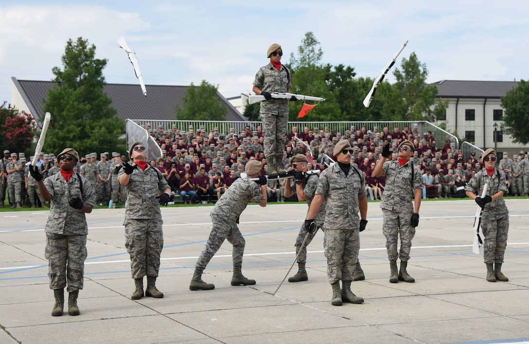 Members of the 335th Training Squadron freestyle drill team perform during the 81st Training Group drill down on the Levitow Training Support Facility drill pad at Keesler Air Force Base, Mississippi, June 15, 2018. Airmen from the 81st TRG competed in a quarterly open ranks inspection, regulation drill routine and freestyle drill routine. (U.S. Air Force photo by Kemberly Groue)
