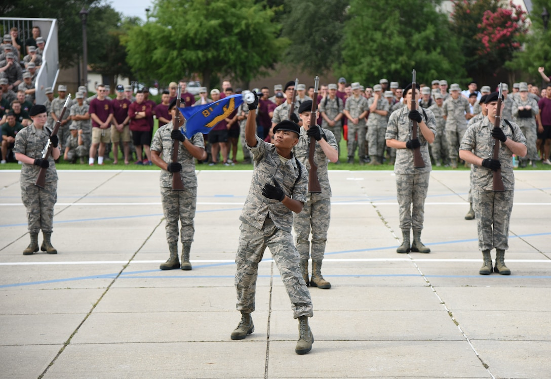 """Members of the 338th Training Squadron freestyle drill team perform during the 81st Training Group drill down on the Levitow Training Support Facility drill pad at Keesler Air Force Base, Mississippi, June 15, 2018. Airmen from the 81st TRG competed in a quarterly open ranks inspection, regulation drill routine and freestyle drill routine. The 338th TRS """"Dark Knights"""" took first place overall this quarter. (U.S. Air Force photo by Kemberly Groue)"""