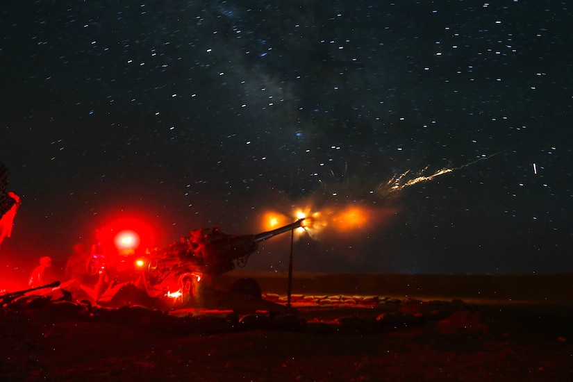 U.S. soldiers and Iraqi Security Force fire a howitzer.