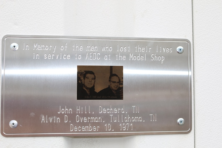 A plaque in memory of John Hill and Alvin Overman hangs on Building 446, the site of their Dec. 10, 1971, deaths. A memorial for the two Model Shop employees was held May 29. The event was also used to remind Manufacturing Group employees of the importance of safety and following procedures. (U.S. Air Force photo/Bradley Hicks)