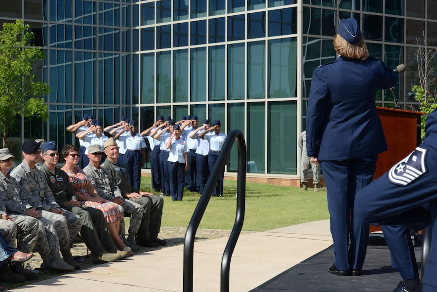 Col. Jennifer Trinket receives her first salute as the new commander of the 72nd Medical Group from members of the clinic during a change of command ceremony June 11.
