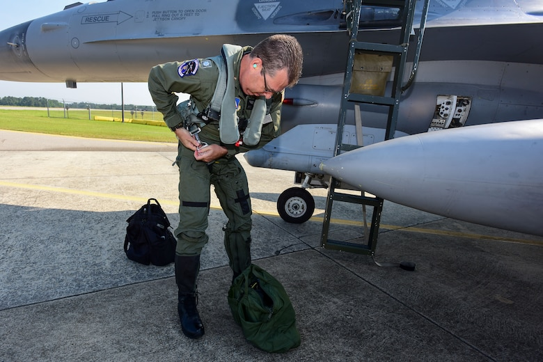 U.S. Civil Air Patrol Lt. Col. Brett Grooms, the legislative commander of the Civil Air Patrol's South Carolina Wing, secures his flight-suit gear prior to an aerospace control alert familiarization flight in an F-16 Fighting Falcon fighter jet from the 169th Fighter Wing here June 11. The 169th FW712, in close coordination with the Continental U.S. North American Aerospace Defense Command Region, the Eastern Air Defense Sector and the Federal Aviation Administration had recently hosted a Southeast Aerospace Control Alert June 5-7 but weather delays precluded Grooms from flying during the actual SACA event. The conference was a total team training initiative to improve homeland defense capabilities by developing techniques with joint forces during small-scale exercises. This conference consisted of South Carolina Air National Guard 169FW F-16 fighter jets, U.S. Coast Guard Rotary Wing Air Intercept Squadron MH-65D Dolphin helicopters from USCG Air Station Atlantic City and South Carolina Wing Civil Air Patrol aircraft and crews to hone their skills with tactical-level air-intercept procedures. (U.S. Air National Guard photo by Senior Airman Megan Floyd)