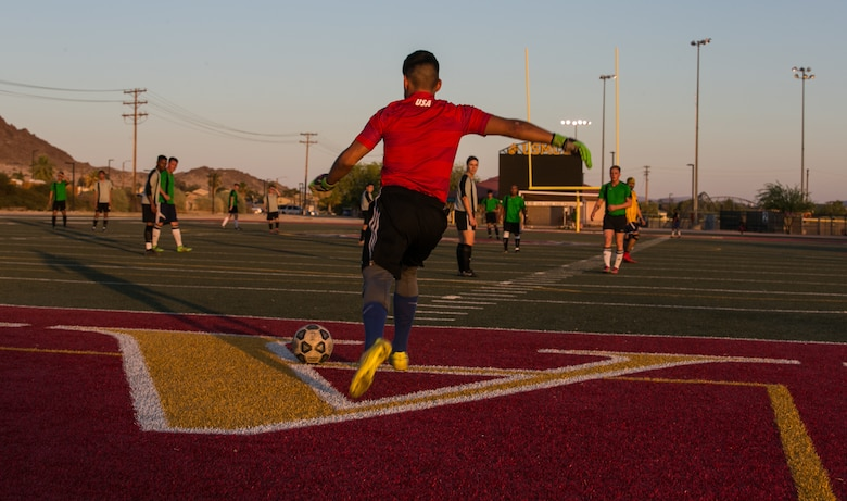 The goalie of the Marine Corps Communication-Electronics School's intramural soccer team takes a goal kick during the installation's intramural soccer finals at Felix Field aboard the Marine Corps Air Ground Combat Center, Twentynine Palms, Calif., June 7, 2018. The MCCES team won 3-0, defeating the Headquarters' Battalion team. The MCCES team defeated the Headquarters Battalion team 3-0. (U.S. Marine Corps photo by Cpl. Francisco Britoramirez)