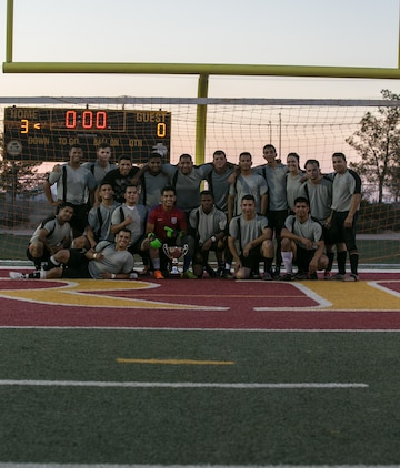 Marine Corps Communication-Electronics School was victorious in the installation's intramural soccer finals at Felix Field aboard the Marine Corps Air Ground Combat Center, Twentynine Palms, Calif., June 7, 2018. The MCCES team defeated the Headquarters Battalion team 3-0.  (U.S. Marine Corps photo by Lance Cpl. Dave Flores)