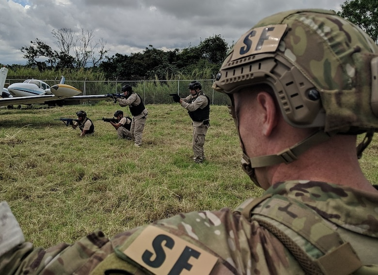 Tech. Sgt. Benjamin Wilson, 571st Mobility Support Advisory Squadron air advisor, assesses students in an air interdiction scenario, during a three-week building partnership capacity mission with the Costa Rican air vigilance service, May 16 through June 9, 2018. The mobility training team's mission was to train and advise the SVA in aircraft interdiction, aircraft maintenance, base defense and dog handling as they continue to counter illicit drug trafficking throughout the region. (U.S. Air Force photo by Capt. LaDarian Outsey)