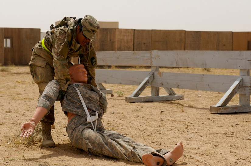 Spc. Dayanna Sanchez, Radiology specialist, 10th Combat Support Hospital, drags a simulated casualty at a physical challenge during the 2016 U.S. Army Central Command Best Warrior Noncommissioned Officer and Soldier of the Year Competition, 19-21 June, at Camp Buehring, Kuwait. Fourteen Soldiers faced off in temperatures nearing 120 degrees competing in multiple events designed to test the Soldiers mental and physical capabilities while focusing on warrior tasks. The events included: a six-mile ruck march, Army physical fitness test, rifle qualification, two physical challenge events, a board appearance, written examination, combatives tournament, and a warrior tasks assessment.