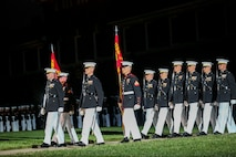 Marines with Marine Barracks Washington D.C. march down Center Walk during a Friday Evening Parade at the Barracks, June 15, 2018.