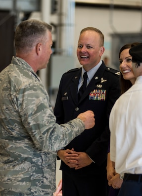 Col. Derek Salmi, 92nd Air Refueling Wing commander, and his wife speak with Brig. Gen. Jeremy Horn, Washington Air National Guard commander, during an assumption of command ceremony June 15, 2018, at Fairchild Air Force Base, Wash. The 92d ARW operates 35 KC-135 R/T Stratotanker aircraft manned by 58 aircrews to support worldwide military missions. (U.S. Air Force photo/ Senior Airman Sean Campbell)