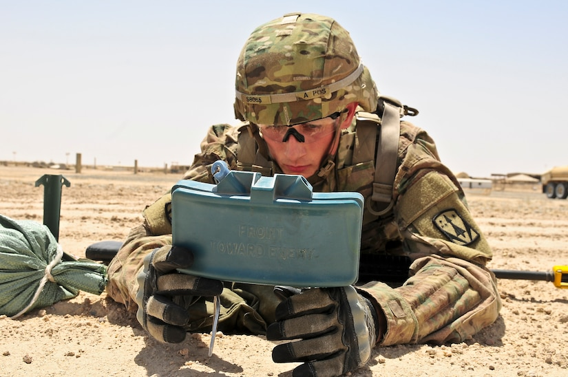 Spc. Drummond Smithson, an air defense battle management system operator with Company A, 5th Battalion, 5th Air Defense Artillery Regiment, disassembles an M18A1 Claymore mine during the 3rd Army Best Warrior Soldier and NCO of the Year Competition June 2. Seven Soldiers vied for the top spot over four days of challenges, including an Army Physical Fitness Test, a 12-mile foot march, various physical challenges, a combatives tournament, Warrior Tasks and Drills, and a comprehensive board covering basic Soldier knowledge.