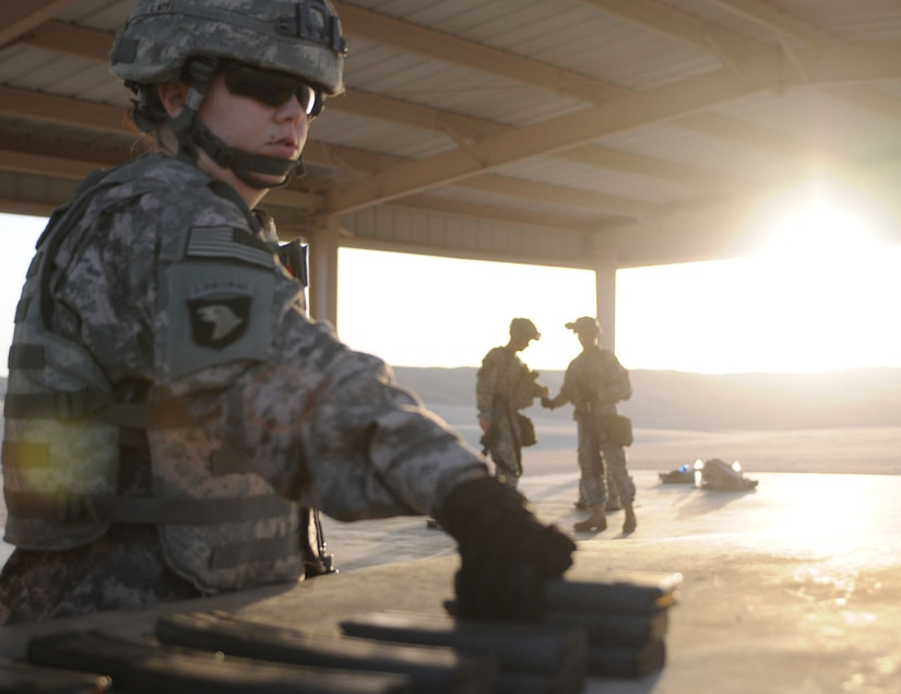"""Sgt. Misty Avila collects rounds for the weapons zeroing and qualification event at Camp Buehring June 5, 2012. Five non-commissioned officers and three soldiers participated in the  """"Third Army/USARCENT 2012 Non-commissioned Officer and Soldierof the Year 'Best Warrior' Competition."""""""