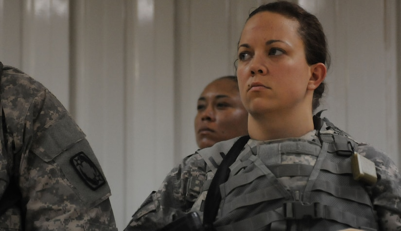 """Sgt. Misty Avila listens to instructions at the warrior drills event at Camp Buehring June 5, 2012. Five non-commissioned officers and three soldiers participated in the """"Third Army/USARCENT 2012 Non-commissioned Officer and Soldier of the Year 'Best Warrior' Competition."""""""