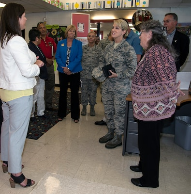 Brig. Gen. Laura L. Lenderman (center), 502nd Air Base Wing and Joint Base San Antonio commander, talks with Amanda Wood (left), Chief, Child and Youth Services Flight, and Jeanne Warren (right), JBSA-Fort Sam Houston Youth Director, during a stop at the JBSA-Fort Sam Houston Youth Center June 15. The general visited the center as part of an immersion tour, which included stops at the Academic Support Center, Student Activity Center, the vehicle maintenance facility, Jimmy Brought Fitness Center, and Military & Family Readiness Center.