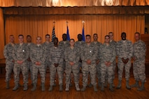 Brig. Gen. Brook Leonard, 56th fighter Wing Commander, and Command Chief Master Sgt. Randy Kwiatkowski, 56th Fighter Wing Command Chief, stand with achievement medal recipients June 13, 2018 at Luke Air Force Base, Ariz. The awarded are Luke's Honor Guard graduates who have successfully served their one-year commitment. (U.S. Air Force photo by Airmen 1st Class Aspen Reid)