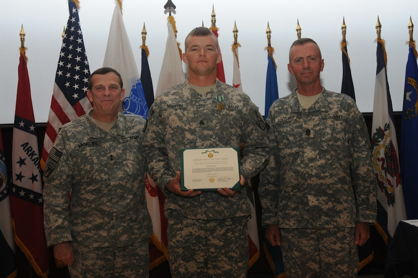 Maj. Gen. Peter M. Vangjel, Third Army Deputy commanding general, and Command Sgt. Maj. John D. Fourhman, Third Army senior enlisted advisor, presents the Army Commendation Medal to Sgt. Jared Lee Martin, a Hendersonville, Tenn., native, after being named Third Army Non-commissioned Officer of the Year 2011. Martin who serves as a lead technician with the 160th Signal Brigade, 335th Signal Command (Theater) (Provisional), will represent Third Army during the U.S. Forces Command Non-commissioned Officer of the Year competition at Fort Hood, Texas.