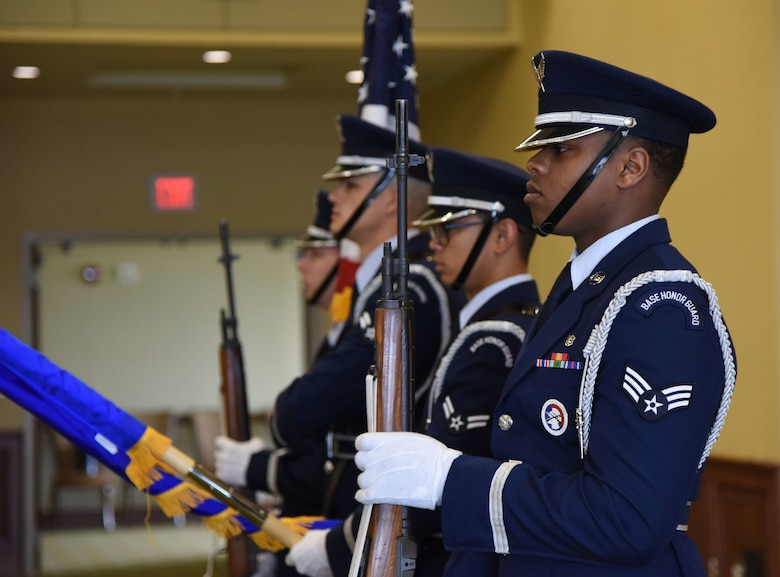 Keesler Honor Guard members present the colors during the 81st Force Support Squadron change of command ceremony in the Bay Breeze Event Center at Keesler Air Force Base, Mississippi, June 14, 2018. The passing of the guidon is a ceremonial symbol of exchanging command from one commander to another. (U.S. Air Force photo by Kemberly Groue)