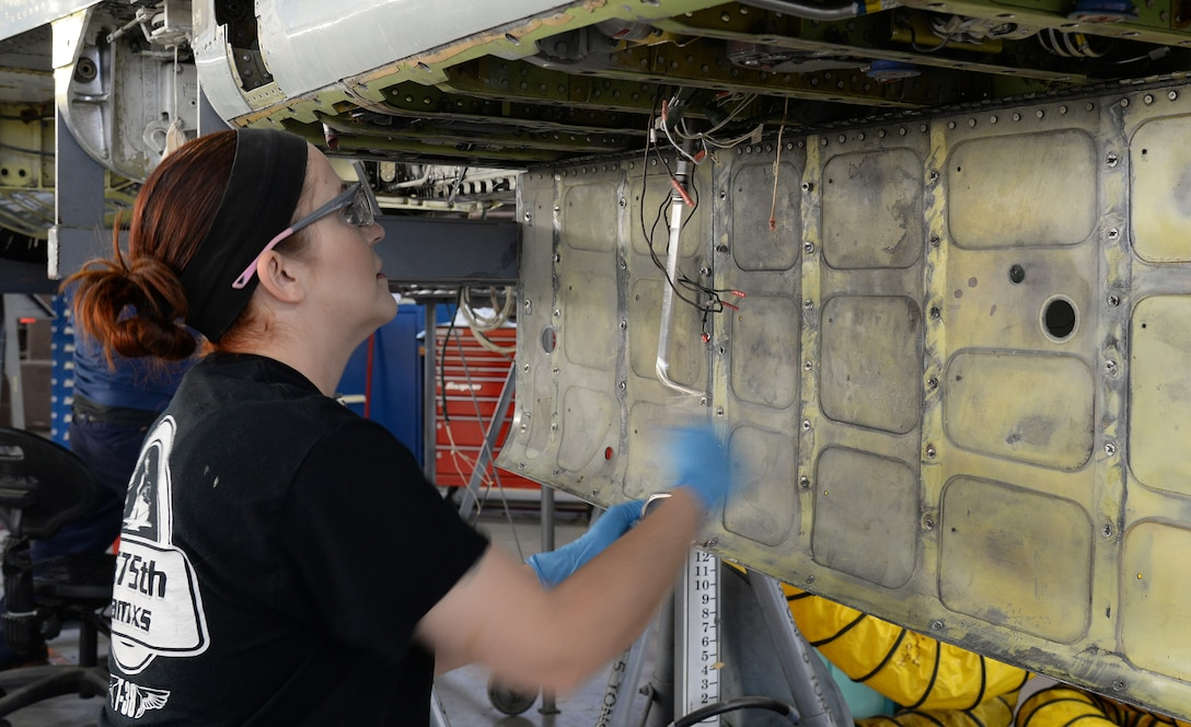 Melanie Blackstock, 575th Aircraft Maintenance Squadron fuels technician, removes screws from a fuel quantity probe April 17, 2018, at Joint Base San Antonio-Randolph, Texas. (U.S. Air Force photo by Alex R. Lloyd)