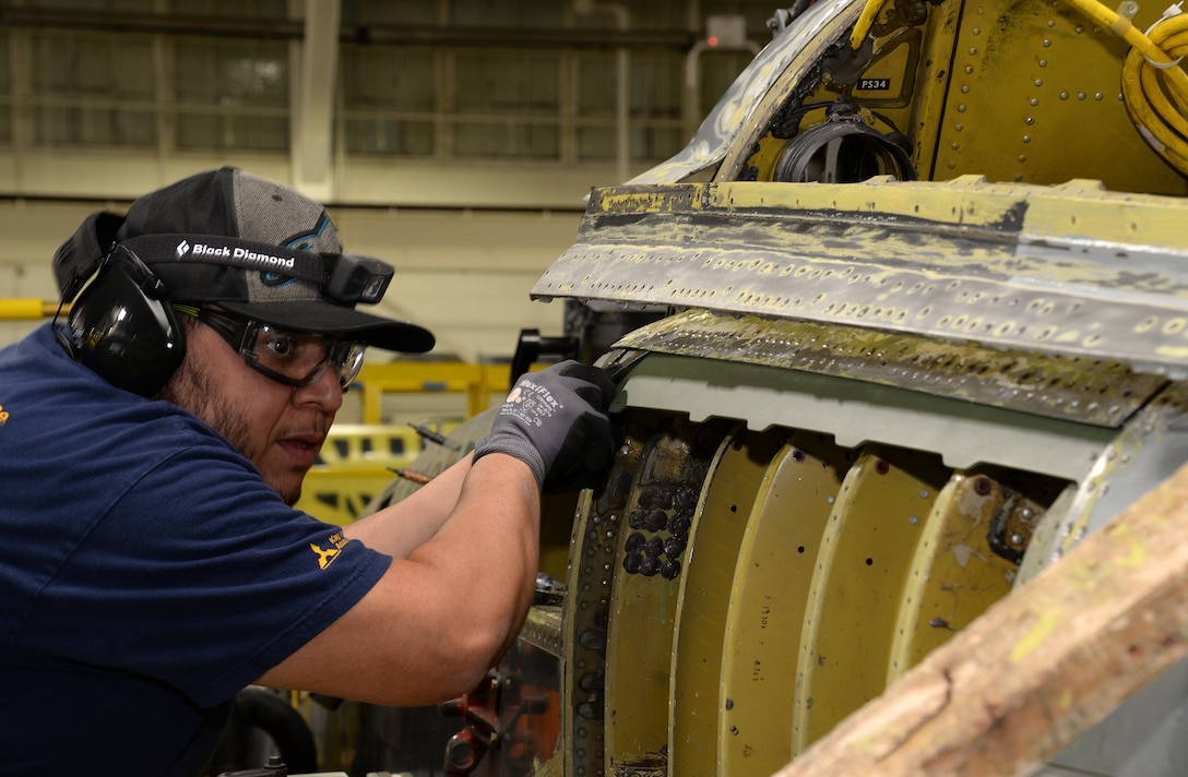 Michael Ramirez, 575th Aircraft Maintenance Squadron sheet metal technician, checks the alignment on a new left hand upper center longeron being installed on a T-38 Talon during the Pacer Classic III modification package April 17, 2018, at Joint Base San Antonio-Randolph, Texas. (U.S. Air Force photo by Alex R. Lloyd)