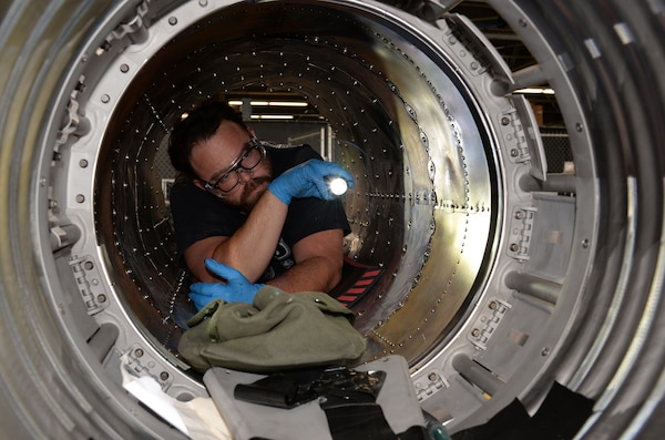 Jason Moore, 575th Aircraft Maintenance Squadron maintenance support flight, inspects the inside of T-38 Talon boat tail section April 17, 2018, at Joint Base San Antonio-Randolph, Texas. (U.S. Air Force photo by Alex R. Lloyd)
