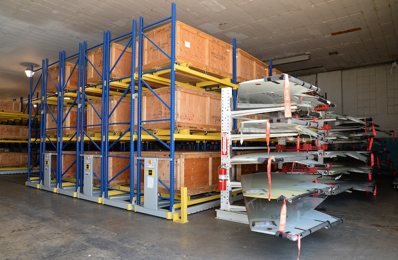 Complete wing sets along with crates holding up to 600 parts from each aircraft are kept safe and ready at Joint Base San Antonio-Randolph, Texas, to be returned to the main production building within minutes compared to hours or days before the new storage rack system was installed. (U.S. Air Force photo by Alex R. Lloyd)
