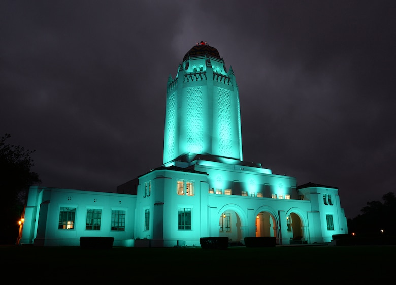 On an overcast morning, building 100 at Joint Base San Antonio-Randolph, Texas, nicknamed the Taj Mahal, glows brightly to welcome a new day. The building was completed in 1931 and is actually a 500,000-gallon water tank along with office space, base movie theater and is the most prominent location on base. (U.S. Air Force photo by Alex R. Lloyd)