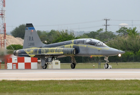 T-38C Talon Instructor Pilot (front), Lt. Col Edward Stapanon III, and Combat Systems Officer (rear), Maj. Brion Nielsen, begin their take-off roll for a training mission April 18, 2018, at Joint Base San Antonio-Randolph, Texas. The aircraft recently completed the Pacer Classic III modification package and still shows its distinctive tiger stripes that will be removed when the aircraft receives its next scheduled complete paint job. (U.S. Air Force photo by Alex R. Lloyd)