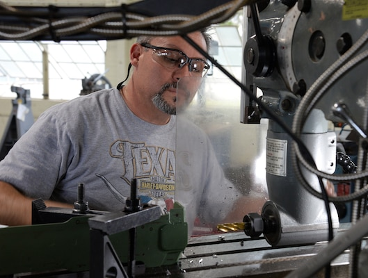 Ricardo Tarin, 575th Aircraft Maintenance Squadron aircraft maintenance machinist, drills new holes into an upper center longeron April 18, 2018, at Joint Base San Antonio-Randolph, Texas, that will be installed on a T-38 Talon during the Pacer Classic III upgrades.  (U.S. Air Force photo by Alex R. Lloyd)