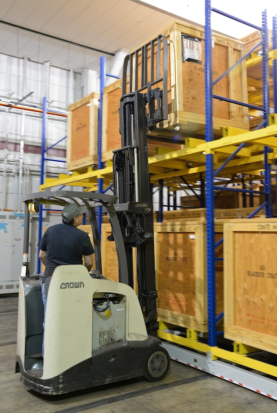 Gilbert De La O uses a forklift April 19, 2018, at Joint Base San Antonio-Randolph, Texas, to retrieve a crate of parts needed on the Pacer Classic III production line. (U.S. Air Force photo by Alex R. Lloyd)