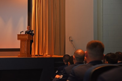 U.S. Air Force Chief Master Sgt. Jason Funkhauser, 315th Training Squadron chief enlisted manager, speaks during a Community College of the Air Force graduation ceremony at the base theater on Goodfellow Air Force Base, Texas, June 15, 2018. Funkhauser told the graduates that they should keep working on their education. (U.S. Air Force photo by Staff Sgt. Joshua Edwards/Released)
