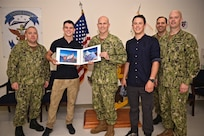 Matt Moniz poses with members of 7th Fleet Staff during his visit to Commander, Fleet Activities Yokosuka and USS Blue Ridge (LCC 19) June 12. Moniz returned a flag, that he flew on top of Mount Everest on May 20, 2018, to 7th Fleet headquarters and took time to learn more about the U.S. Navy while in Yokosuka.