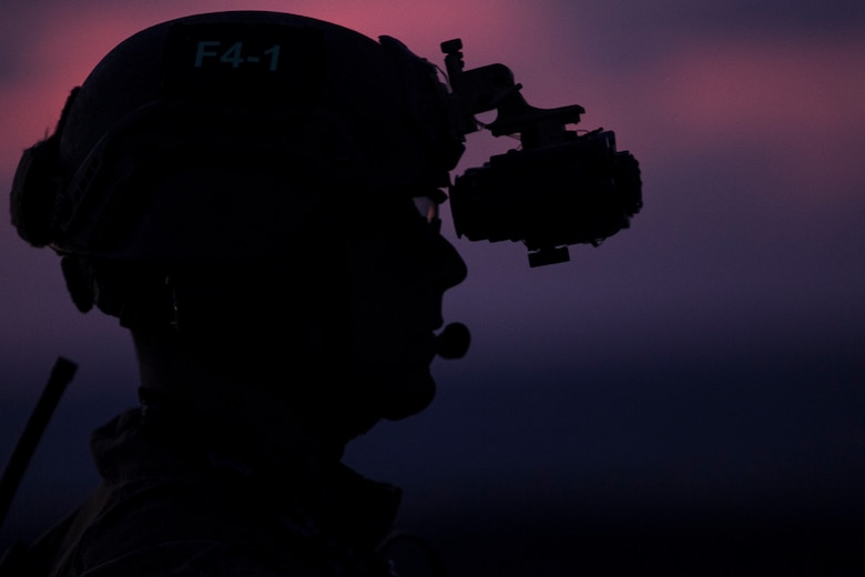 A Marine with the 31st Marine Expeditionary Unit's Force Reconnaissance Platoon waits on the flight deck before low-light fast rope training aboard the USS Bonhomme Richard, underway in the Pacific Ocean, June 25, 2017. The FRP Marines train regularly for quick, tactical raids of targets on both land and sea. Fast roping allows Marines to enter inaccessible locations via rope from a hovering aircraft. The 31st MEU partners with the Navy's Amphibious Squadron 11 to form the amphibious component of the Bonhomme Richard Expeditionary Strike Group. The 31st MEU and PHIBRON 11 combine to provide a cohesive blue-green team capable of accomplishing a variety of missions across the Indo-Asia-Pacific region.