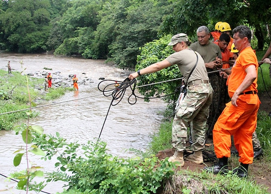 NHARNG 1st Lt. Katrina Simpson, an infantry officer with Mountain Company, works with Salvadoran soldiers and firefighters to complete a rope system spanning the Lempa River in El Salvador June 7, 2018. The swift water rescue training, led by Maj. Brian Fernandes, deputy commander, 12th Civil Support Team, brought N.H. Guardsmen, Salvadoran soldiers and firefighters together to focus on sharing ideas and best practices for rescue techniques to improve interoperability between civilian and military personnel.