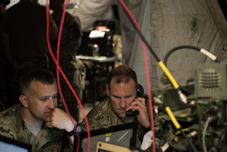 Master Sgt. Benjamin Lake, 146th Air Support Operations Squadron (146th ASOS) chief of weapons and tactics, coordinates a simulated air strike during a combat scenario with Lt. Col. Craig Ilschner, commander of the 146th ASOS, during Warfighter 18-5 (WFX-18-5) June 10, 2018, at Camp Atterbury Joint Maneuver Training Center near Edinburgh, Indiana. WFX-18-5 was conducted to help components of the 34th Infantry Division become accustomed to using Army battle drills in a computer-simulated combat environment. (U.S. Air National Guard photo by Staff Sgt. Brigette Waltermire)