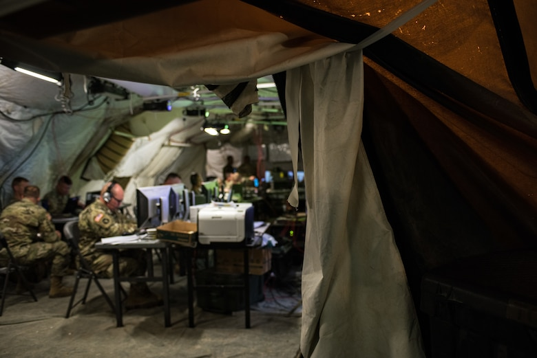 Soldiers with the Minnesota Army National Guard 1st Armored Brigade Combat Team, 34th Infantry Division, use a mobile tactical operations center to conduct combat simulations as a response cell during Warfighter 18-5 (WFX 18-5) June 11, 2018, at Camp Atterbury Joint Maneuver Training Center near Edinburgh, Indiana. WFX 18-5 was conducted to help components under the 34th Infantry Division become accustomed to using Army battle drills in a computer-simulated combat environment. (U.S. Air National Guard photo by Staff Sgt. Brigette Waltermire)