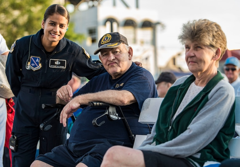 Tech. Sgt. Nalani Quintello, Max Impact vocalist, Washington, D.C., poses for a photo with U.S. Navy veteran David Bethard, a Millsboro, Del., resident, June 16, 2018, at the bandstand in Rehoboth Beach, Del. Bethard served four years as a cook onboard the USS Everglades (AD-24) before making his home in Delaware. Max Impact, the premier rock band of the U.S. Air Force, is stationed at Joint Base Anacostia-Bolling in Washington, D.C. (U.S. Air Force photo by Roland Balik)