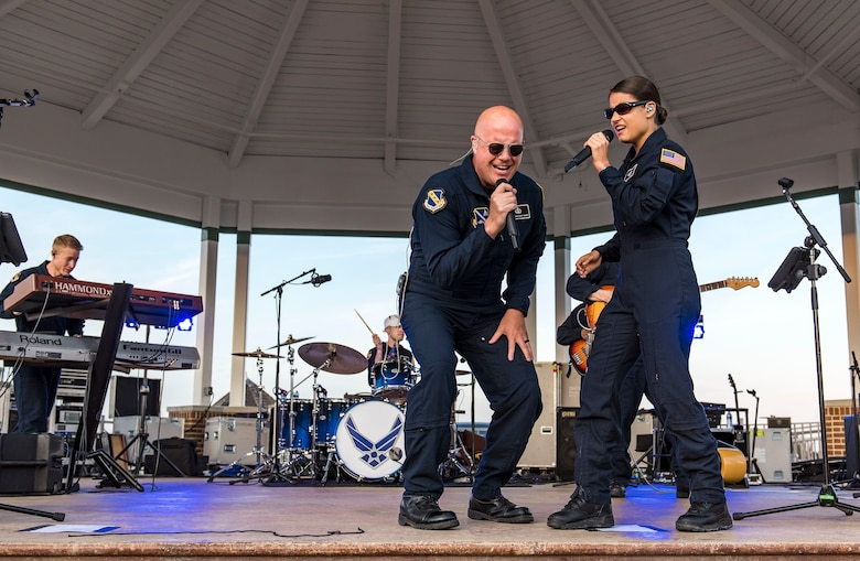 Senior Master Sgt. Ryan Carson, Max Impact superintendent and vocalist, and Tech. Sgt. Nalani Quintello, Max Impact vocalist, perform a song together June 16, 2018, on the bandstand at Rehoboth Beach, Del. Max Impact, the premier rock band of the U.S. Air Force, is stationed at Joint Base Anacostia-Bolling in Washington, D.C. (U.S. Air Force photo by Roland Balik)
