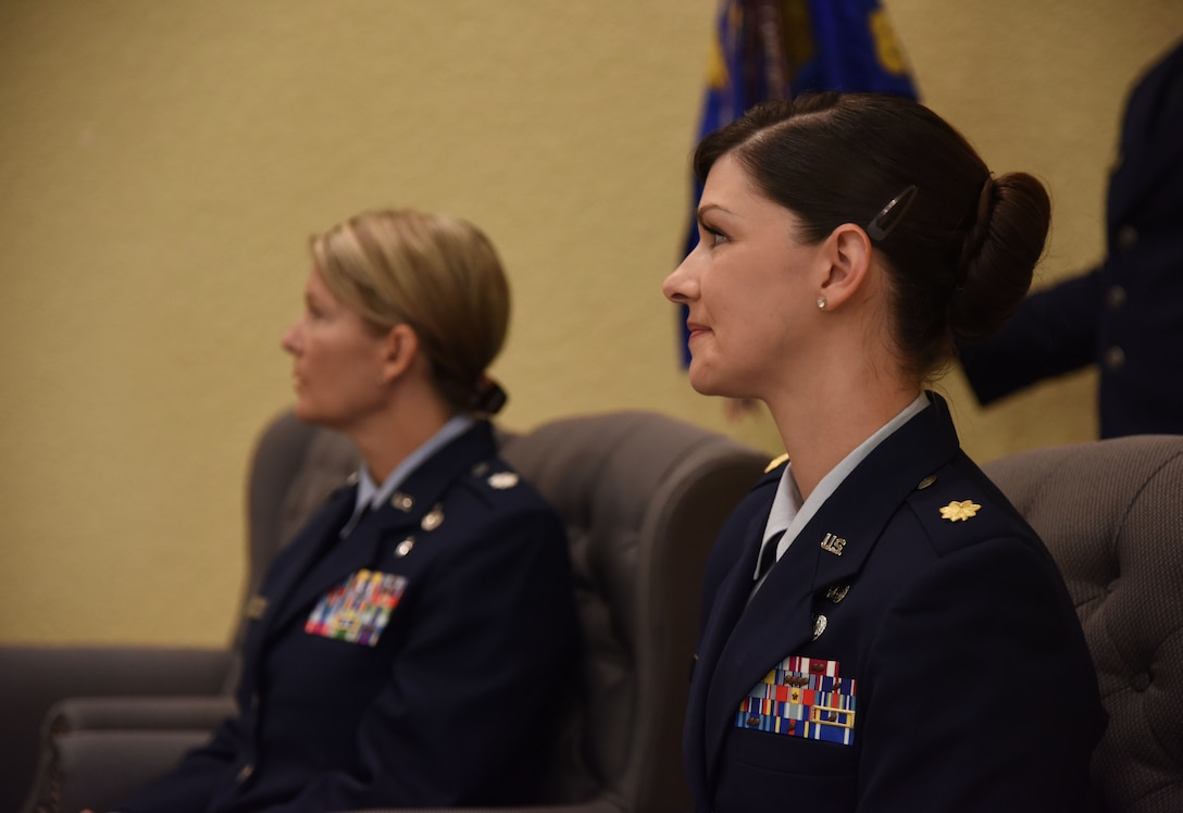 U.S. Air Force Lt. Col. Teresa Ammons, outgoing 81st Force Support Squadron commander, and Maj. Amber Ortiz, incoming 81st FSS commander, attend the 81st FSS change of command ceremony in the Bay Breeze Event Center at Keesler Air Force Base, Mississippi, June 14, 2018. The passing of the guidon is a ceremonial symbol of exchanging command from one commander to another. (U.S. Air Force photo by Kemberly Groue)