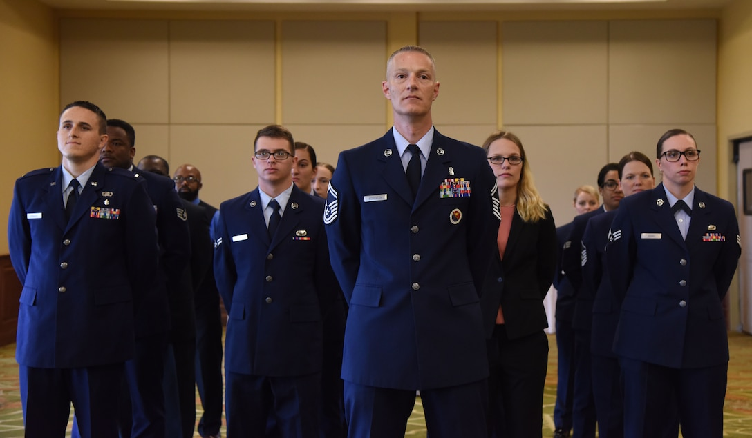 U.S. Air Force Senior Master Sgt. David Boydston, Airman Leadership School commandant, stands in formation with Keesler personnel during the 81st Force Support Squadron change of command ceremony in the Bay Breeze Event Center at Keesler Air Force Base, Mississippi, June 14, 2018. The passing of the guidon is a ceremonial symbol of exchanging command from one commander to another. (U.S. Air Force photo by Kemberly Groue)